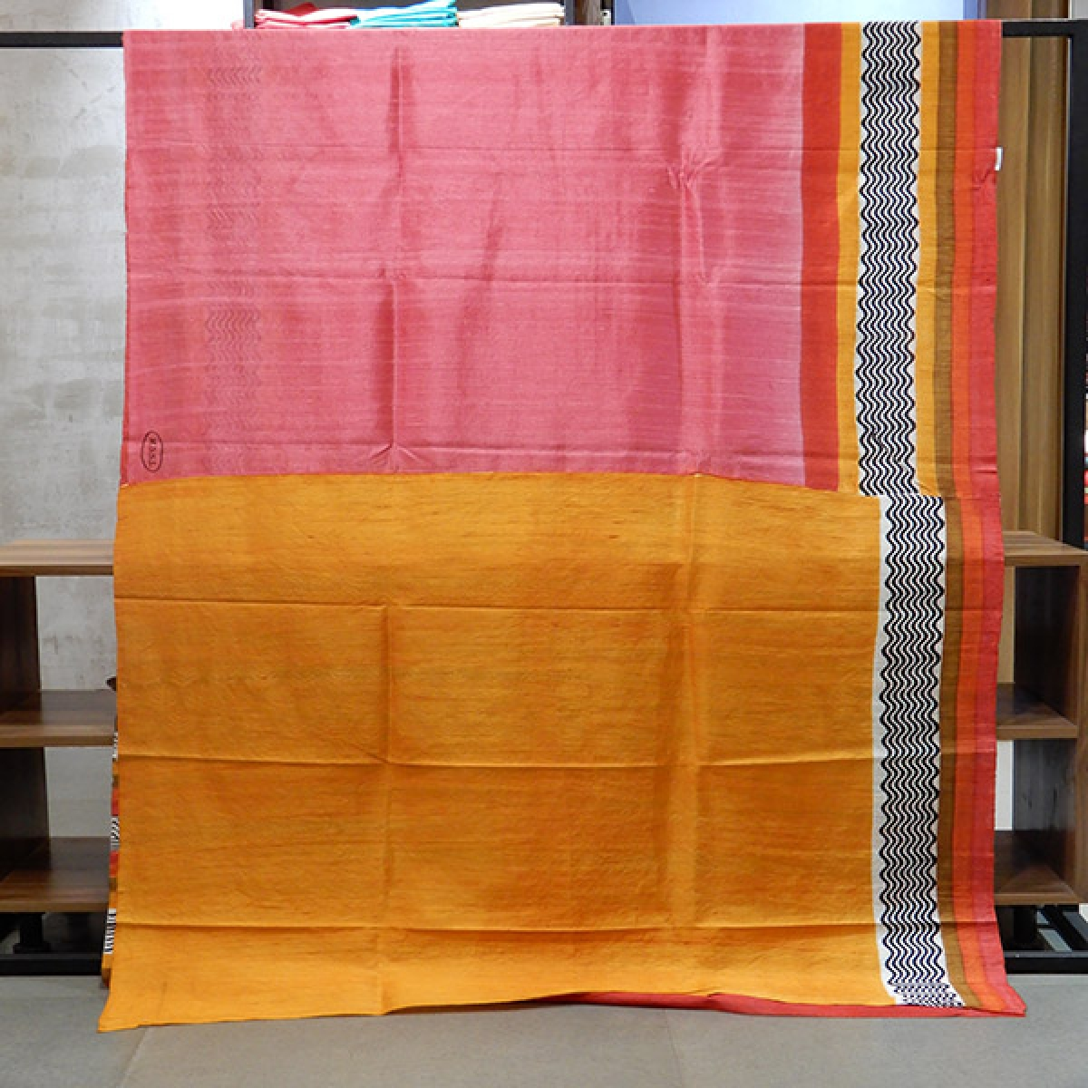 Pure Raw Silk saree with warm colours and printed border.Blouse piece attached.