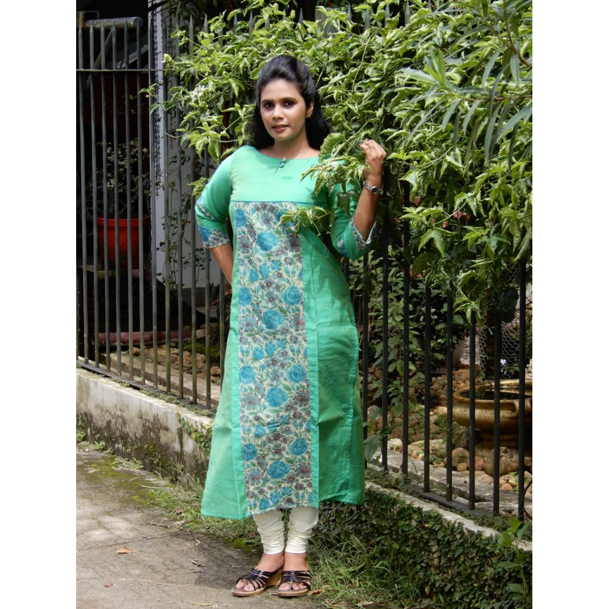 Pastel green chandheri cotton with pattern and paneling  of floral printed phulkari kota and button  detailing on boat neck